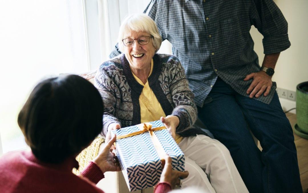 Cheerful senior woman recieving a gift box | PHC Tennessee